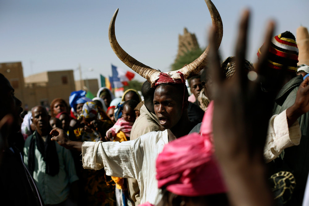 Description of . Well-wishers gather to greet French President Francois Hollande during his two-hour-long visit to Timbuktu, Mali, Saturday Feb. 2, 2013. (AP Photo/Jerome Delay)