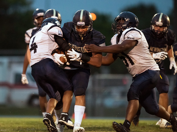 09/07/18 Wesley Bunnell | Staff Newington defeated Amistad Academy on Friday night in Newington. Julian Mulero (44) with a carry.