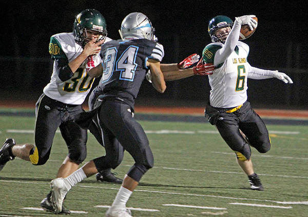 Los Alamos' Leander Murphy, number 30, tries to clear Capital's Abraham Sanchez, number 34, out of the way of Jack Stewart, number 6, during the second quarter of the Capital High School vs Los Alamos High School football game at Capital on Friday, November 3, 2017. Luis Sánchez Saturno/The New Mexican