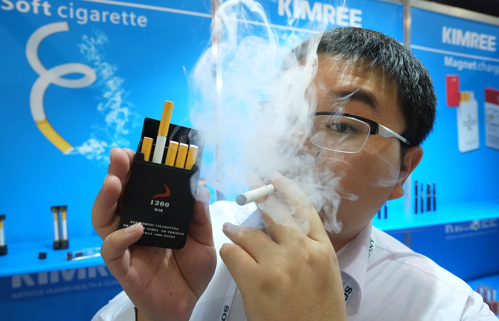 . Bin Zhou of Kimree shows electronic cigarettes at the Kimree booth during the 2014 International CES at the Las Vegas Convention Center on January 8, 2014 in Las Vegas, Nevada. CES, the world\'s largest annual consumer technology trade show, runs through January 10 and is expected to feature 3,200 exhibitors showing off their latest products and services to about 150,000 attendees. AFP PHOTO/JOE KLAMAR/AFP/Getty Images