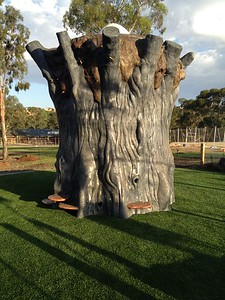 giant hollow tree fort sculpture