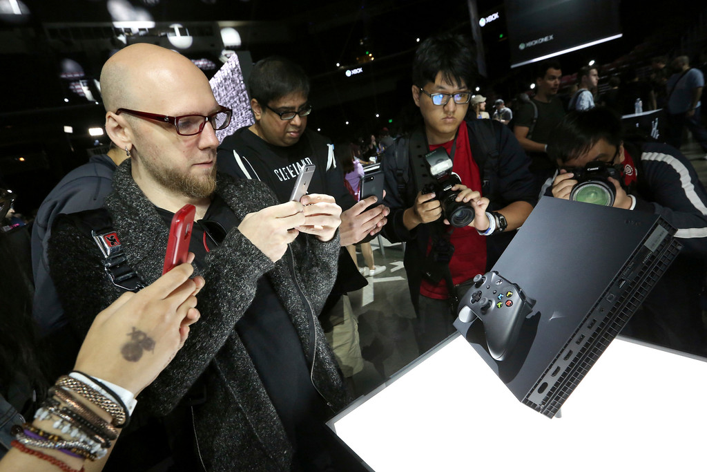 . IMAGE DISTRIBUTED FOR MICROSOFT - Fans interact with the Xbox One X at the Xbox Media Showcase at E3 2017 in Los Angeles on Monday, June 12, 2017. (Photo by Casey Rodgers/Invision for Microsoft/AP Images)