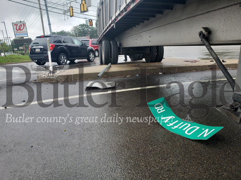 A tractor trailer collided with a state trooper's vehicle at about 11 a.m. Wednesday at the intersection of New Castle and Duffy roads. Tanner Cole/Butler Eagle