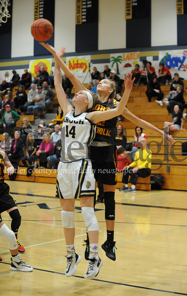 North Catholic #21 Kylee Lewandowski goes for the steal aganst Knoch #14 Neveah Ewing during a game at Knoch Gym on Monday January 13, 2020 (Jason Swanson photo)
