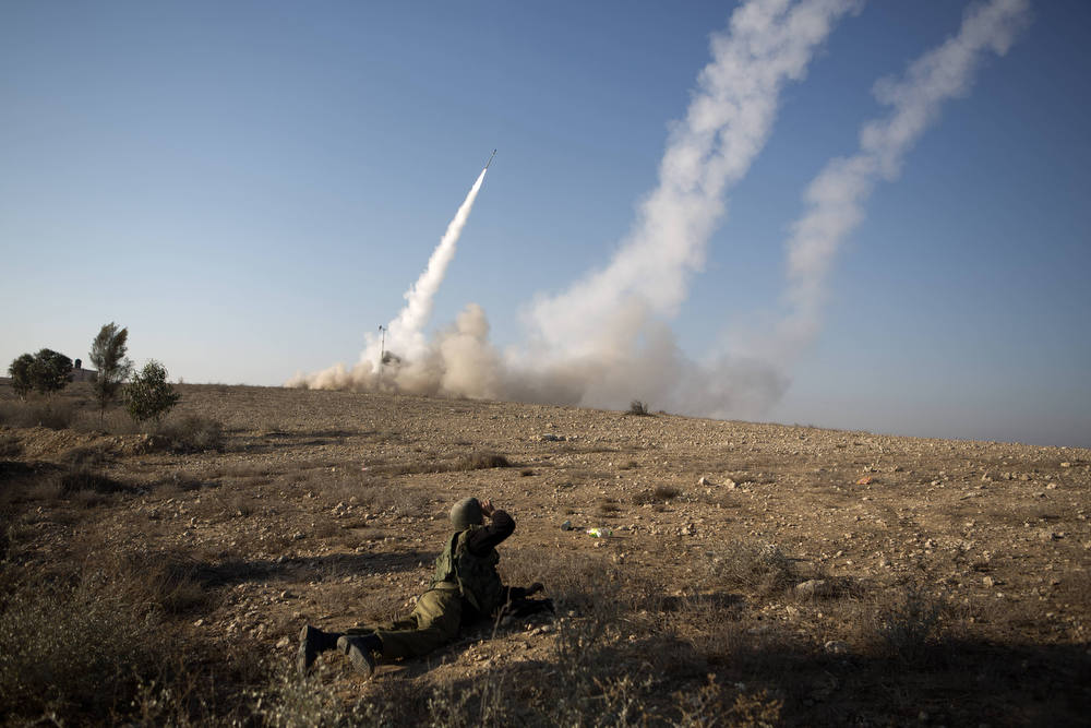 Description of . The Israeli military launch a missile from the Iron Dome air defence system, designed to intercept and destroy incoming short-range rockets and artillery shells, in the southern city of Beer Sheva following the firing of rockets from the Gaza Strip on November 15, 2012.  Rockets were launched from Gaza into Israel amid a vast Israeli operation against Gaza militants which began on November 14 with the killing of a top Hamas chief along with ten other Palestinians. AFP PHOTO/MENAHEM KAHANA/AFP/Getty Images