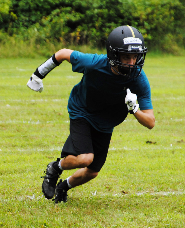 . Jon Behm - The Morning Journal<br> Scenes from North Olmsted\'s first day of football practice on July 30.