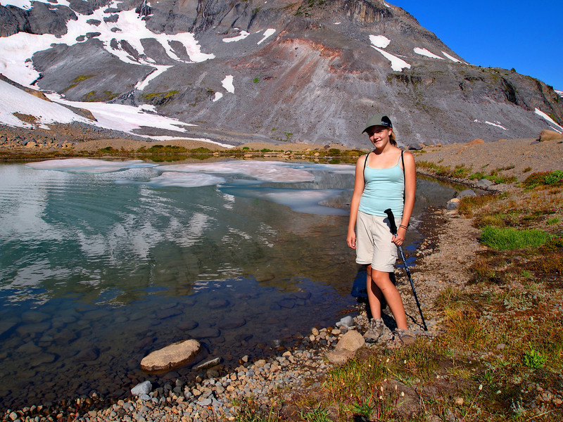 Emily by a little glacial lake under Panhandle Gap.