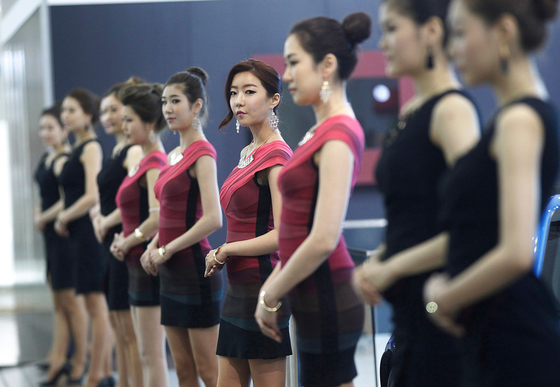 . Models stand during a press day of the Seoul Motor Show in Goyang, South Korea, Thursday, March 28, 2013. The exhibition will be held from March 29 to April 7 and will feature 384 companies from 14 countries. (AP Photo/Ahn Young-joon)
