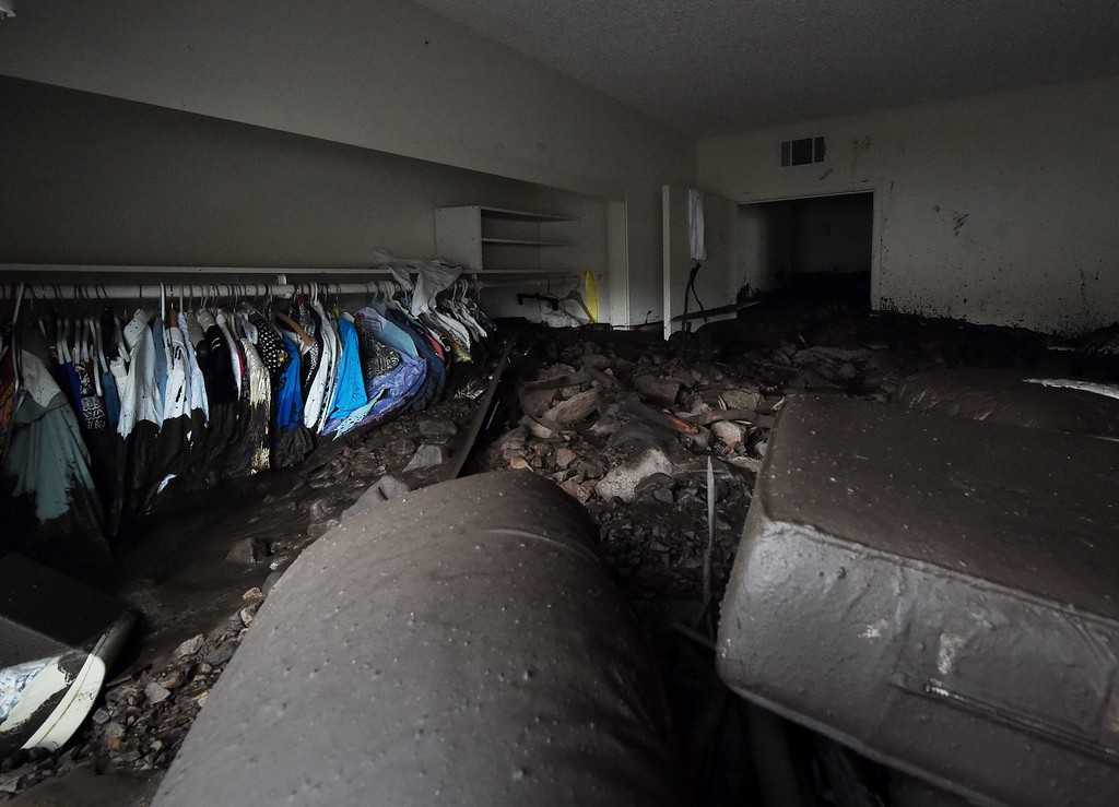 . Houses damaged in San Como Lane after heavy rain triggered a mudslide following a storm in the Camarillo Springs area of Ventura County, California on December 12, 2014.  The US Pacific coast\'s most ferocious storm in years moved south Friday, bringing hurricane force winds and heavy downpours to southern California one day after claiming two lives in the Northwest.                      AFP PHOTO/MARK RALSTON/AFP/Getty Images