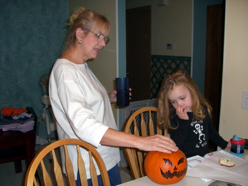 Inspecting the soon to be jack-o-lantern.