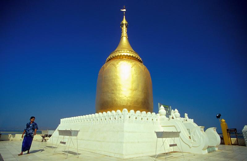 Burmese Woman beside Golden Spire of Bupaya (Bu Paya) Entrance Pagoda in Bagan, Burma (Myanmar)