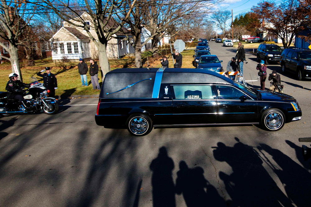 Description of . A hearse carries the casket of Sandy Hook Elementary School shooting victim Victoria Soto from the Lordship Community Church following her funeral in Stratford, Connecticut, December 19, 2012. Six victims of the Newtown school shooting will be honored at funerals and remembrances on Wednesday. REUTERS/Lucas Jackson
