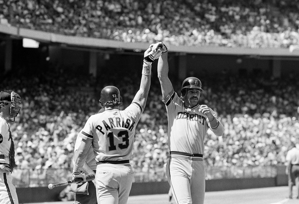 . Detroit Tigers� Kirk Gibson, right, and Lance Parrish slap hands at home plate after Gibson hit a home run in the sixth inning against the California Angeles in Anaheim, California on August 27, 1984. (AP Photo/Lennox McLendon)