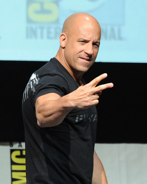 """. SAN DIEGO, CA - JULY 19:  Actor Vin Diesel speaks onstage at the \""""Kick-Ass 2\"""" and \""""Riddick\"""" Panels during Comic-Con International 2013 at San Diego Convention Center on July 19, 2013 in San Diego, California.  (Photo by Kevin Winter/Getty Images)"""