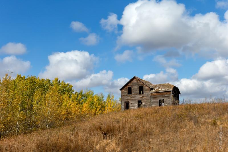 Farm house on a hill, Saskatchewan, Canada