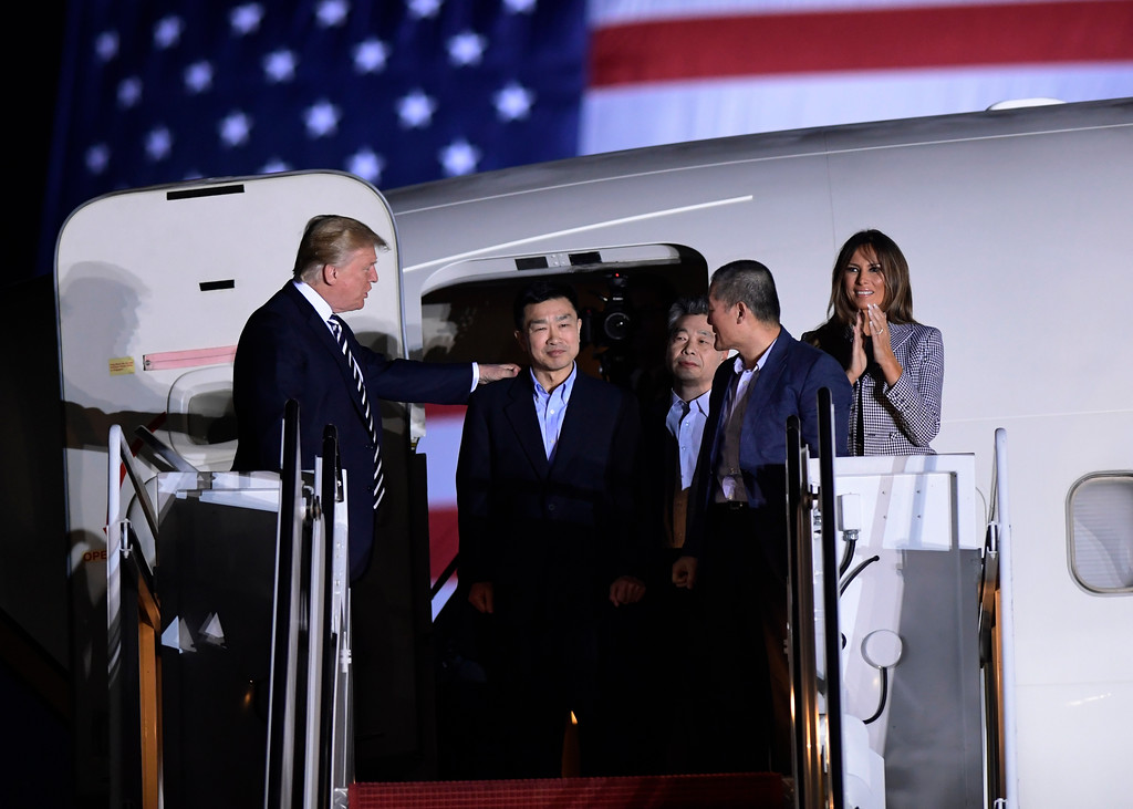 . President Donald Trump, from left, greets Tony Kim, Kim Hak Song and Kim Dong Chul, three Americans detained in North Korea for more than a year, as they arrive at Andrews Air Force Base in Md., Thursday, May 10, 2018. First lady Melania Trump also greets them at right. (AP Photo/Susan Walsh)