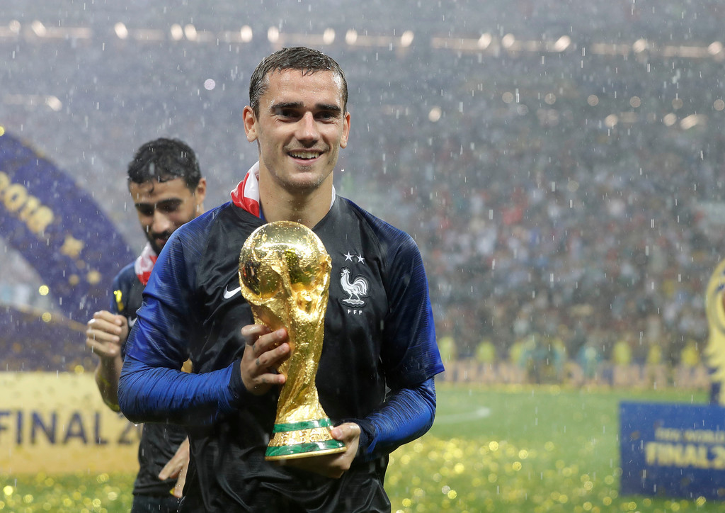 . France\'s Antoine Griezmann celebrates with the trophy after the final match between France and Croatia at the 2018 soccer World Cup in the Luzhniki Stadium in Moscow, Russia, Sunday, July 15, 2018. France won the final 4-2. (AP Photo/Matthias Schrader)