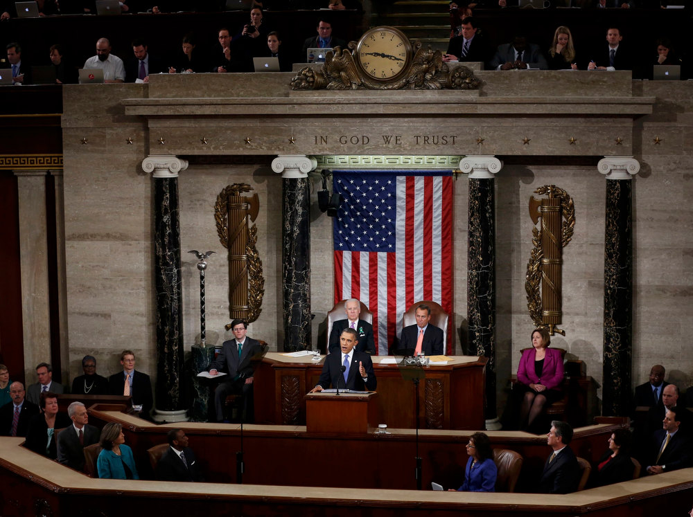 Description of . U.S. President Barack Obama (C) starts to deliver his State of the Union Speech as Vice President Joe Biden (rear, L) and House Speaker John Boehner (R-OH) (rear, R) listen on Capitol Hill in Washington, February 12, 2013.  REUTERS/Kevin Lamarque