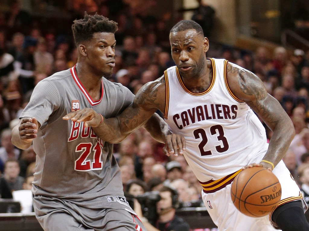 . Cleveland Cavaliers\' LeBron James (23) drives past Chicago Bulls\' Jimmy Butler (21) in the second half of an NBA basketball game Saturday, Jan. 23, 2016, in Cleveland. The Bulls won 96-83. (AP Photo/Tony Dejak)