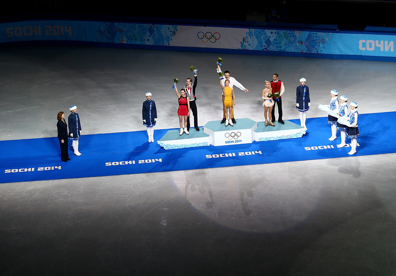 . (L-R) Silver medalists Ksenia Stolbova and Fedor Klimov of Russia, gold medalists Tatiana Volosozhar and Maxim Trankov of Russia, bronze medalists Aliona Savchenko and Robin Szolkowy of Germany celebrate on the podium during the flower ceremony for the Figure Skating Pairs event during day five of the 2014 Sochi Olympics at Iceberg Skating Palace on February 12, 2014 in Sochi, Russia.  (Photo by Clive Mason/Getty Images)