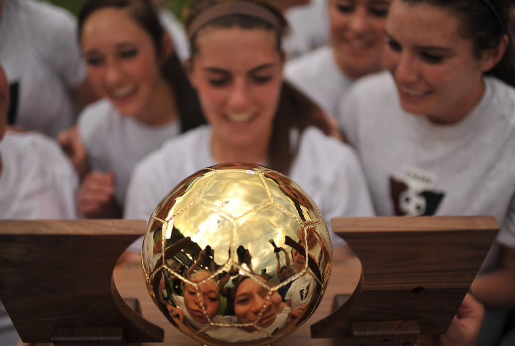 . COMMERCE CITY, CO. - MAY 22 : Cheyenne Mountain High School soccer players kiss the trophy of  4A girl\'s soccer championship at Dick\'s Sporting Goods Park. Commerce City, Colorado. May 22, 2013. Cheyenne Mountain High School won against Broomfield High School 2-0. (Photo By Hyoung Chang/The Denver Post)