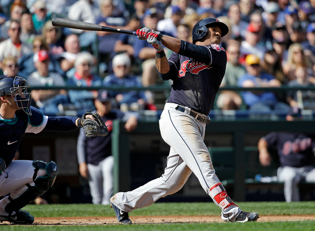 . Cleveland Indians\' Jose Ramirez drives in a run on a sacrifice fly as Seattle Mariners catcher Mike Zunino looks on in the third inning of a baseball game Saturday, Sept. 23, 2017, in Seattle. (AP Photo/Elaine Thompson)