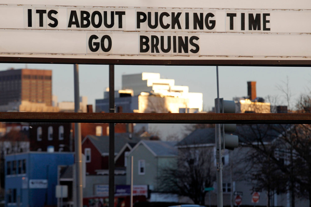 ". A sign outside of a liquor store reads, ""It\'s About Pucking Time Go Bruins\"" in Somerville, Massachusetts January 19, 2013. The Boston Bruins will take on the New York Rangers tonight during their season home opener NHL hockey game. REUTERS/Jessica Rinaldi"