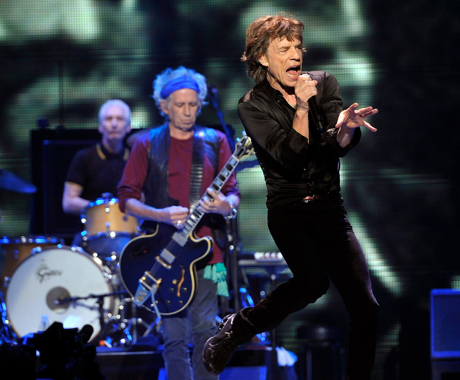 ". Mick Jagger, right, Keith Richards, center, and Charlie Watts of the Rolling Stones perform at the kick-off of the band\'s ""50 and Counting\"" tour at the Staples Center on Friday, May 3, 2013 in Los Angeles. (Photo by Chris Pizzello/Invision/AP)"