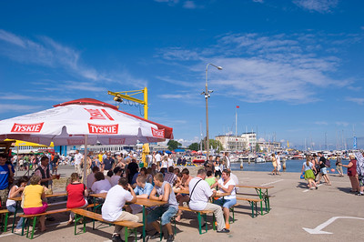 People relax in a bar on Kosciuszko Square by the marina, Gdynia, Poland