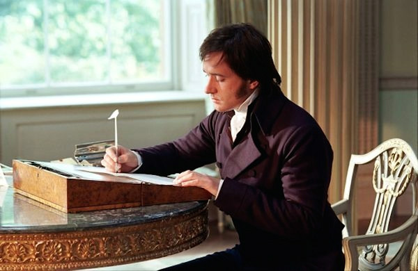 Darcy writing at desk.jpg