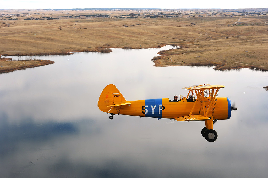 . Former WASP Lucile Wise, 92, is flying high while riding in a 1942 Boeing-Stearman being flown by pilot Chad Graves. The Women Airforce Service Pilots of World War II, or WASP\'s, were the first women to fly military aircraft.  They fought hard to receive veteran status and didn\'t get it until 1977, long after their history had been buried. This year, they are celebrated at the 10th annual gala for Wings Over the Rockies. There are 7 surviving WASPs in Colorado--four will be at the gala, plus 10 from other states.  Lucile Wise, 92, is a veteran WASP.  Today, November 5th, 2012, she was treated to a ride on a 1942 Boeing-Stearman biplane, exactly like the one in which she first trained during World War II.  aHelen H. Richardson, The Denver Post