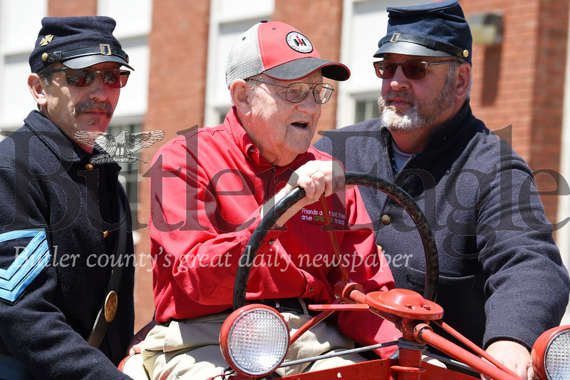 Harold Aughton/Butler Eagle: Harold McDowell, 94, uses his 1947 Farmall to carry Glenn Wissinger, (on left) and his son, George McDowell of the 12th Pennsylvania Reserve Volunteers, Army of the Potomac during the Harrisville Memorial Day Parade.