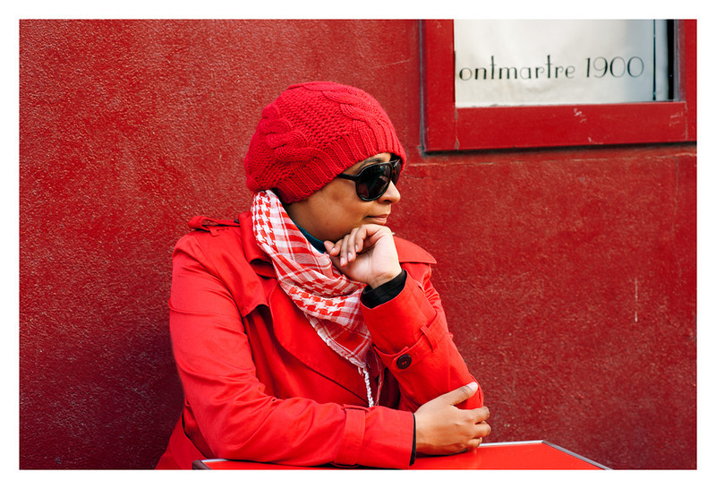 No post-processing here - red wall, red coat, red hat and red table - the perfect storm of color.