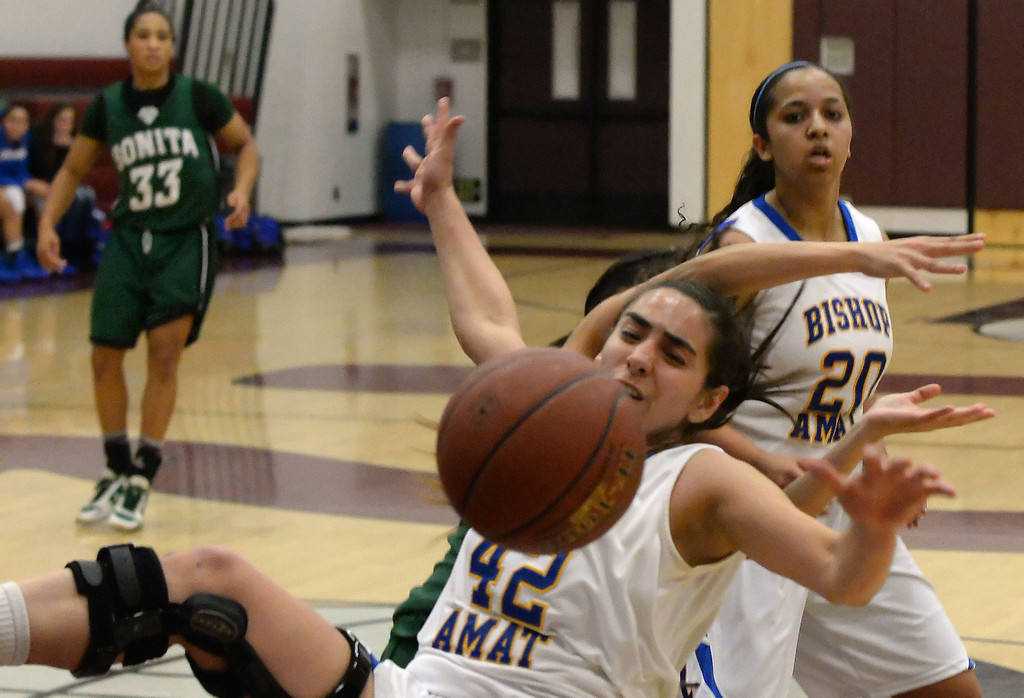 . Bishop Amat\'s Dagmar Ramirez (42) scrambles for the loose ball against Bonita in the first half of the Covina basketball tournament at Covina High School in Covina, Calif., on Saturday, Dec. 14, 2013. Bonita won 49-41.   (Keith Birmingham Pasadena Star-News)