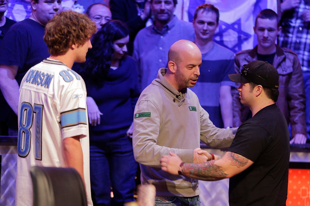 . Amir Lehavot , center, shakes hands with Jay Farber, right, as Ryan Riess  looks on after Lehavot was eliminated from play during the World Series of Poker Final Table, Tuesday, Nov. 5, 2013, in Las Vegas. (AP Photo/Julie Jacobson)
