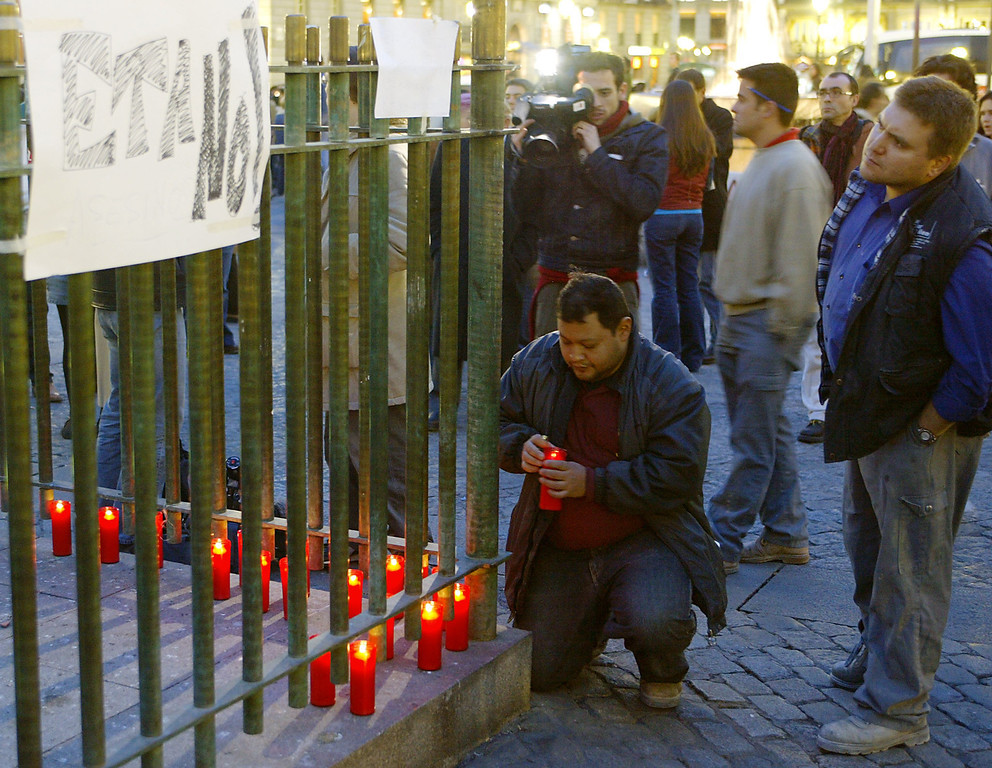 . A person lights a candle as people gather at la Puerta del Sol place in the center of Madrid after a train exploded at the Atocha train station, 11 March 2004. At least 173 people were killed and some 600 injured early 11 March 2004 in near-simultaneous explosions on three trains in Madrid at the height of morning commuter traffic, the Spanish interior ministry said. In what appeared to be a deliberate attack staged only 72 hours ahead of Spanish general elections, the blasts went off on a long-distance high-speed carrier and two suburban trains packed with commuters. JACK GUEZ/AFP/Getty Images