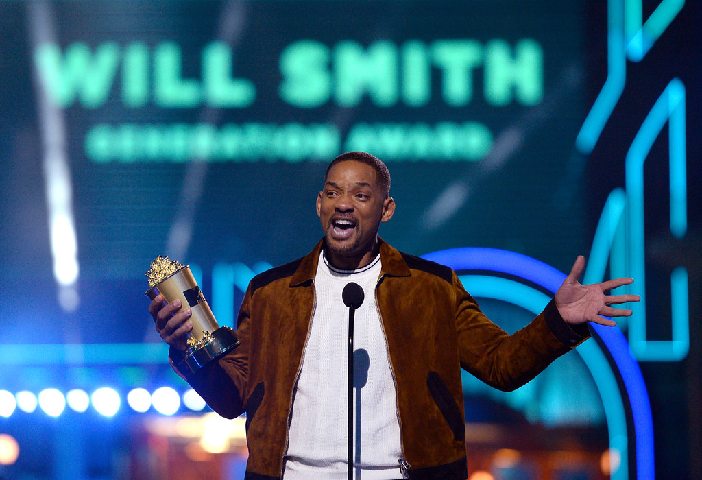 . Will Smith accepts the generation award at the MTV Movie Awards at Warner Bros. Studio on Saturday, April 9, 2016, in Burbank, Calif. (Kevork Djansezian/Pool Photo via AP)