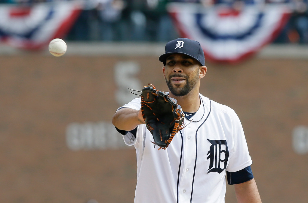 . Detroit Tigers starting pitcher David Price waits on a ball in the ninth inning of an opening day baseball game against the Minnesota Twins in Detroit, Monday, April 6, 2015. (AP Photo/Carlos Osorio)