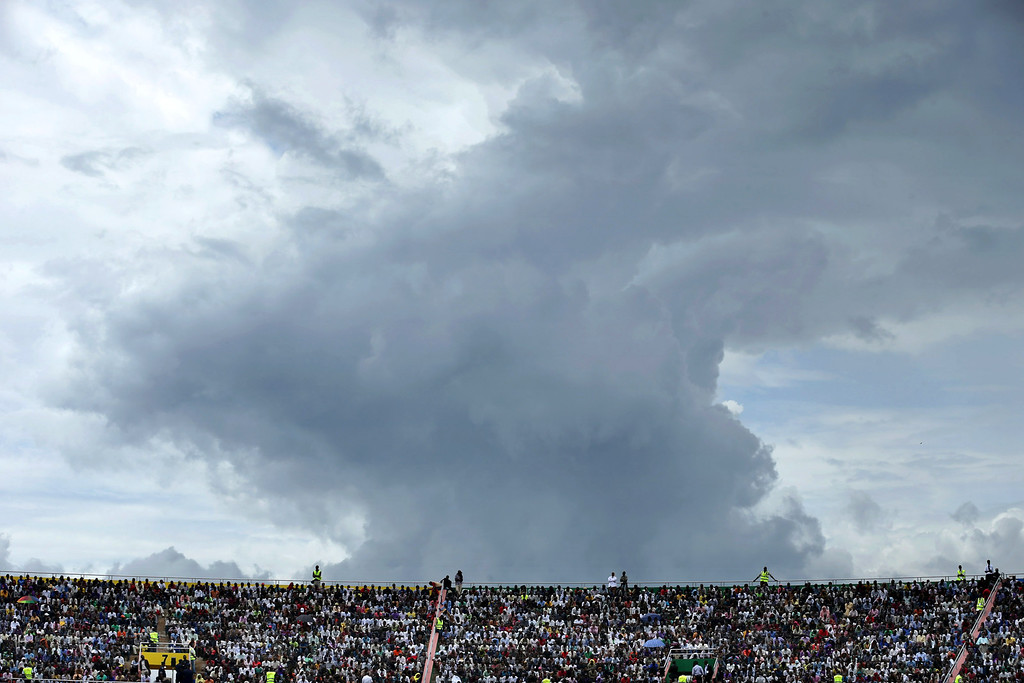 . The sky threatens rain as tens of thousands of people gather to commemorate the 20th anniversary the 1994 genocide at Amahoro Stadium April 7, 2014 in Kigali, Rwanda.  (Photo by Chip Somodevilla/Getty Images)