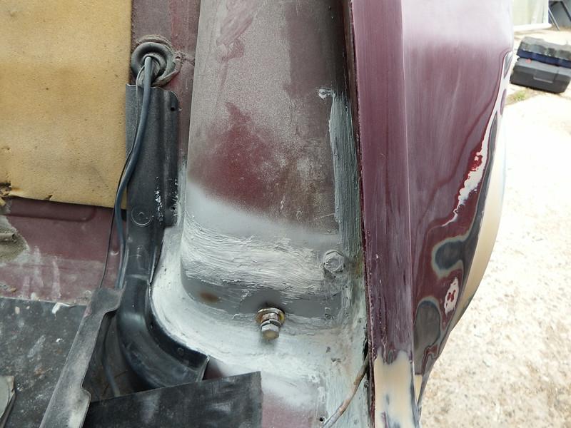 Same rusty seatbelt mount repaired