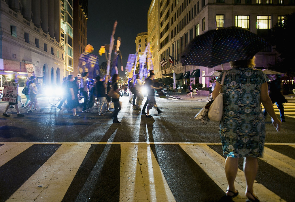 . WASHINGTON, DC - AUGUST 21:  Protesters march in support of Bradley Manning on August 21, 2013 in Washington, DC. Manning was sentenced to 35 years in jail for leaking hundreds of thousands of classified documents to the anti-secrecy group WikiLeaks.  (Photo by T.J. Kirkpatrick/Getty Images)