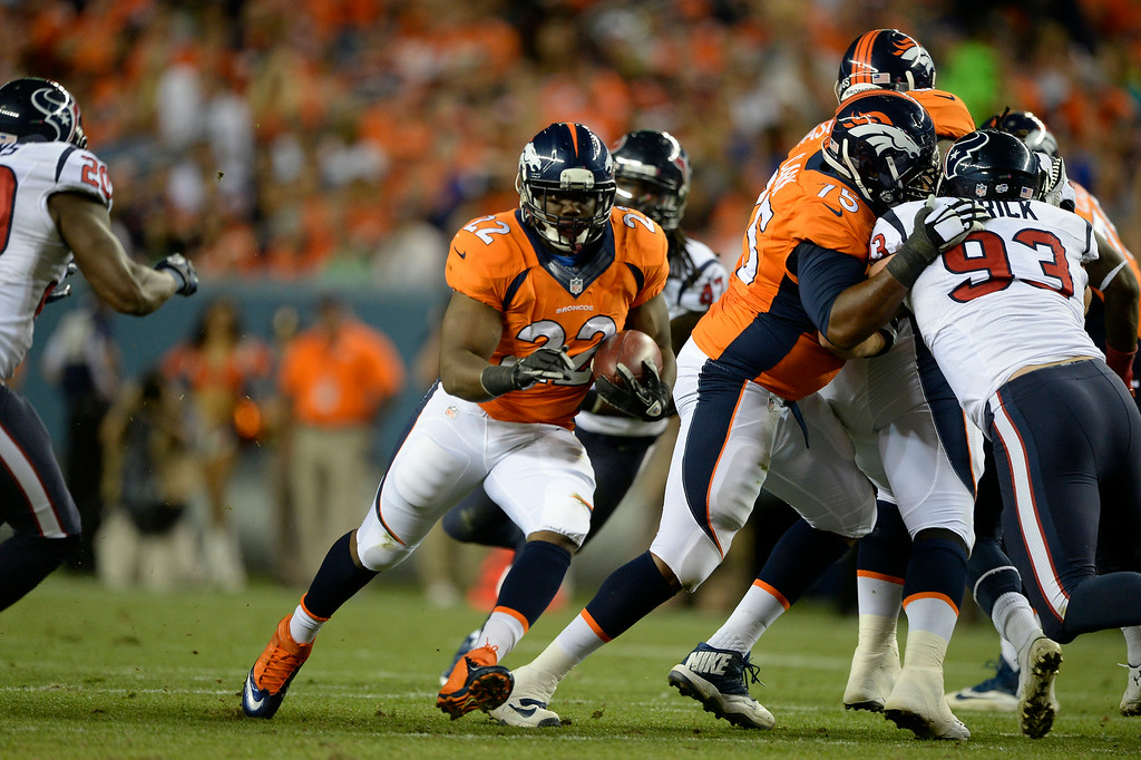 . DENVER, CO - AUGUST 23: Denver Broncos running back C.J. Anderson (22) finds a hole in the Houston Texans defense during the second quarter August 23, 2014 at Sports Authority Field at Mile High Stadium. (Photo by John Leyba/The Denver Post)
