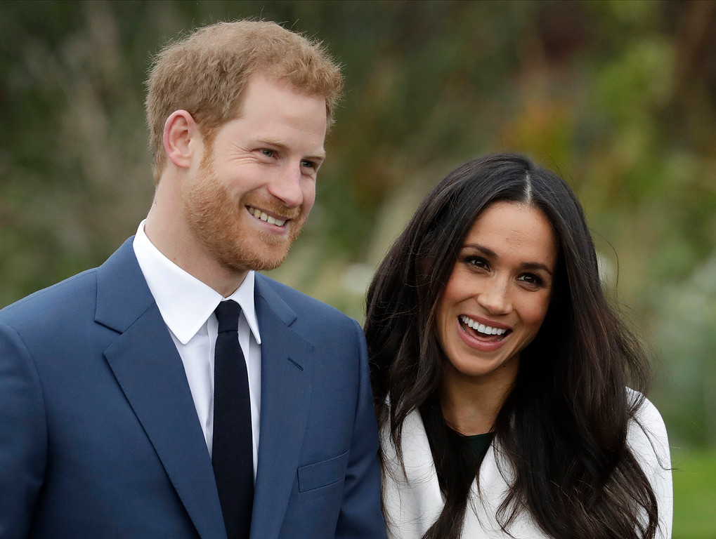 . Britain\'s Prince Harry and his fiancee Meghan Markle pose for photographers during a photocall in the grounds of Kensington Palace in London, Monday Nov. 27, 2017. Britain\'s royal palace says Prince Harry and actress Meghan Markle are engaged and will marry in the spring of 2018. (AP Photo/Matt Dunham)