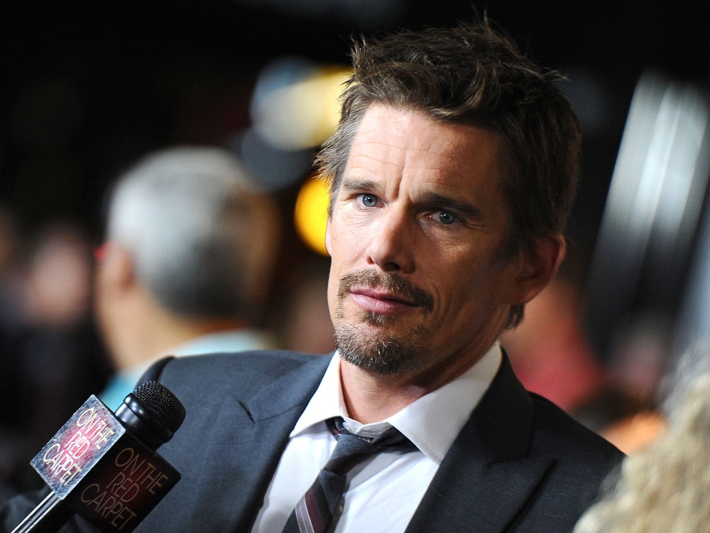 Description of . Actor Ethan Hawke arrives to the screening of Summit Entertainment\'s \'Sinister\' at Landmark Theatres Regent on October 1, 2012 in Los Angeles, California.  (Photo by Angela Weiss/Getty Images)