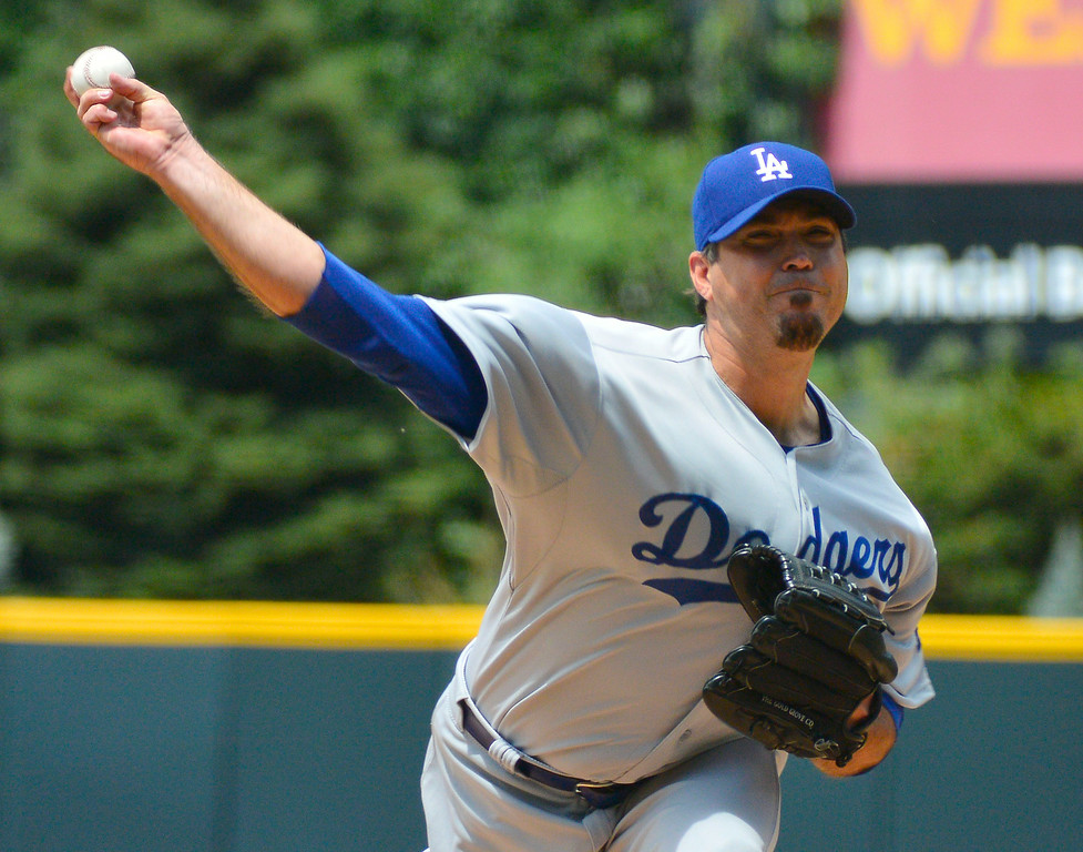 . Los Angeles Dodgers starting pitcher Josh Beckett (61) delivers a pitch against the Colorado Rockies July 6, 2014 at Coors Field. (Photo by John Leyba/The Denver Post)