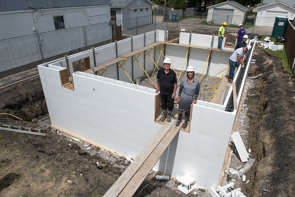 DAVID LIPNOWSKI / WINNIPEG FREE PRESS   Project coordinator of St. Vital interfaith habitat build Alf Horn, and Vice President communications and philanthropy Michelle Pereira on site where the basement is being poured on Ross Ave. W. Monday June 27, 2016.