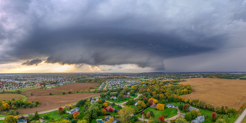 Stormy weather over emerging fall foliage.