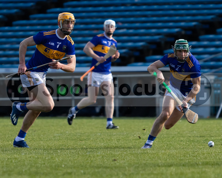 Tipperary's Cathal Barrett (2) and Barry Heffernan (6) chase after the sliotar as Michael Breen (9) looks on