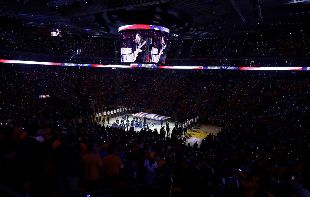 . Carlos Santana performs the national anthem before Game 2 of basketball\'s NBA Finals between the Golden State Warriors and the Cleveland Cavaliers in Oakland, Calif., Sunday, June 4, 2017. (AP Photo/Marcio Jose Sanchez)