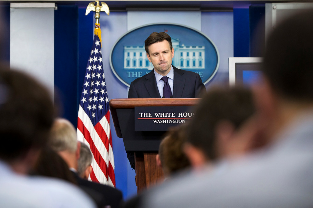 . White House press secretary Josh Earnest pauses while speaking about the militant group al-Shabab in Somalia, during his daily news briefing at the White House in Washington, Tuesday, Sept. 2, 2014. Earnest also spoke about reports that a video on the internet that purports to show beheading of US reporter Steven Sotloff by Islamic State group. (AP Photo/Jacquelyn Martin)